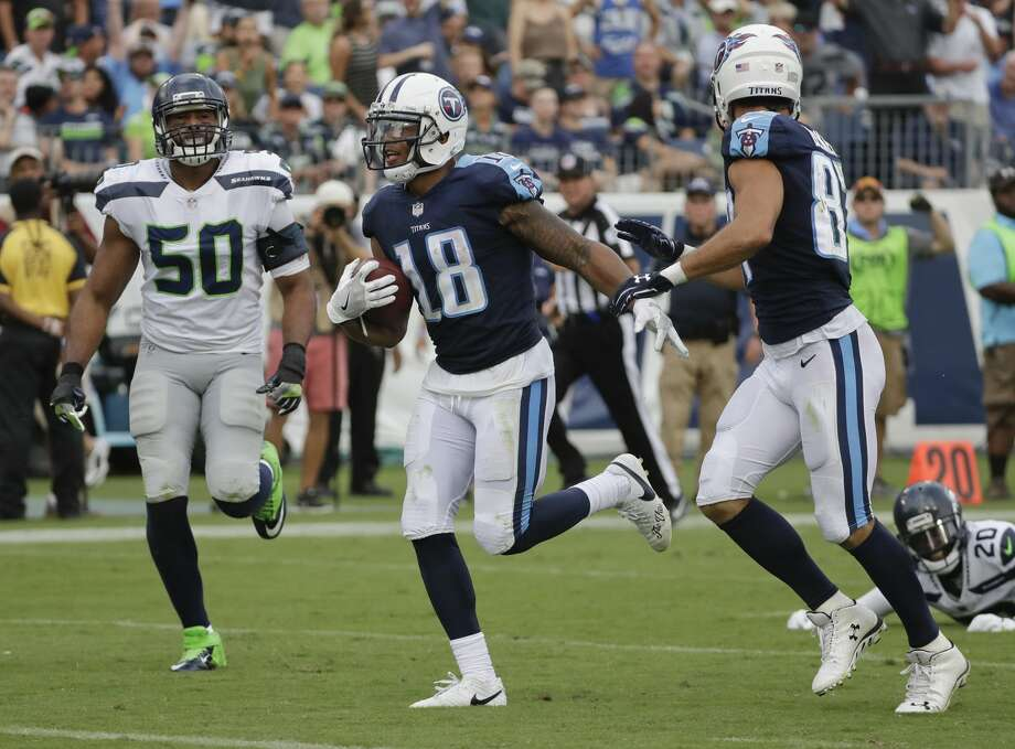 "Punches land against the Legion of Boom It seems the two-minute offense ignited something for the Titans in the same way it did for the Seahawks. After Seattle scored just before the half, Tennessee marched straight down the field and answered with three points, taking a 9-7 lead at the break. After that, the Titans scored three straight touchdowns and a field goal, gashing Seattle's vaunted defense on the ground and through the air. The Titans racked up 420 total yards, 195 on the ground, a shockingly high number considering how stout Seattle has been against the run in the past half decade. Seattle's defense also prides itself on limiting big plays, though Tennessee had scoring plays of 55 and 75 yards. Both plays featured poor angles on tackles, missed tackles and players out of position. ""We haven't seen those,"" coach Pete Carroll said of what he described as ""uncharacteristic"" plays by his team.  Photo: James Kenney/AP"