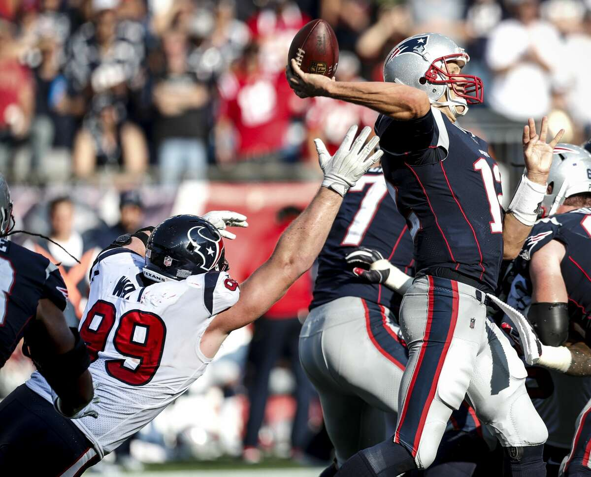 Houston Texans defensive end J.J. Watt (99) reaches out in vain to stop New England Patriots quarterback Tom Brady (12), as he throws for a 27-yard completion to Danny Amendola and a first down during the fourth quarter of an NFL football game at Gillette Stadium on Sunday, Sept. 24, 2017, in Foxbourough, Mass. ( Brett Coomer / Houston Chronicle )