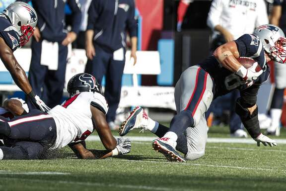 New England Patriots tight end Rob Gronkowski (87) dives out of the grasp of Houston Texans inside linebacker Zach Cunningham (41) for a first down reception during the fourth quarter of an NFL football game at Gillette Stadium on Sunday, Sept. 24, 2017, in Foxbourough, Mass. ( Brett Coomer / Houston Chronicle )
