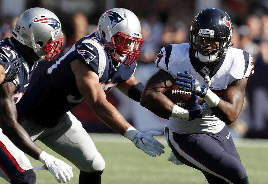 Houston Texans running back D'Onta Foreman (27) runs outside with New England Patriots free safety Devin McCourty (32) and linebacker Kyle Van Noy (53) defensing during the fourth quarter of an NFL football game at Gillette Stadium on Sunday, Sept. 24, 2017, in Foxbourough, Mass. ( Brett Coomer / Houston Chronicle ) Photo: Brett Coomer/Houston Chronicle