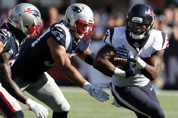 Houston Texans running back D'Onta Foreman (27) runs outside with New England Patriots free safety Devin McCourty (32) and linebacker Kyle Van Noy (53) defensing during the fourth quarter of an NFL football game at Gillette Stadium on Sunday, Sept. 24, 2017, in Foxbourough, Mass. ( Brett Coomer / Houston Chronicle )