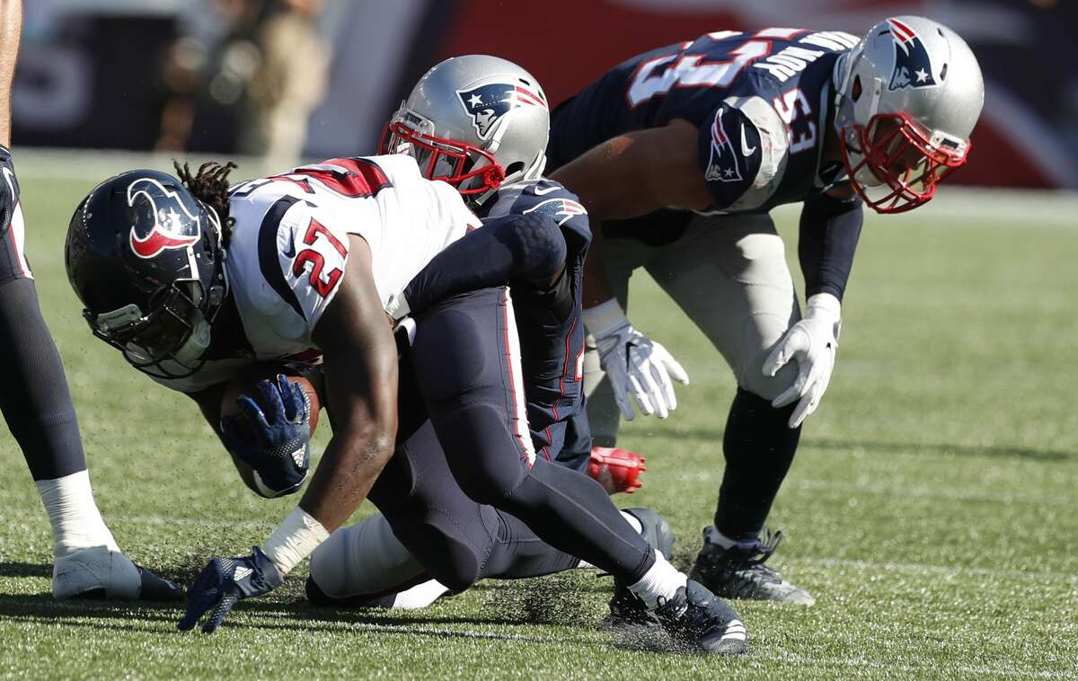 Houston Texans running back D'Onta Foreman (27) runs against the New England Patriots during the fourth quarter of an NFL football game at Gillette Stadium on Sunday, Sept. 24, 2017, in Foxbourough, Mass. ( Brett Coomer / Houston Chronicle )