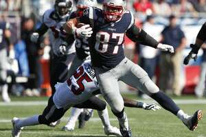 New England Patriots tight end Rob Gronkowski (87) runs past Houston Texans cornerback Kareem Jackson (25) for a first down reception during the third quarter of an NFL football game at Gillette Stadium on Sunday, Sept. 24, 2017, in Foxbourough, Mass. ( Brett Coomer / Houston Chronicle )