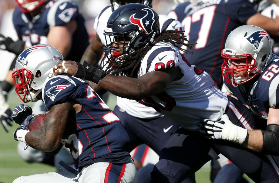 Houston Texans outside linebacker Jadeveon Clowney (90) tackles New England Patriots running back Mike Gillislee (35) during the third quarter of an NFL football game at Gillette Stadium on Sunday, Sept. 24, 2017, in Foxbourough, Mass. ( Brett Coomer / Houston Chronicle ) Photo: Brett Coomer/Houston Chronicle
