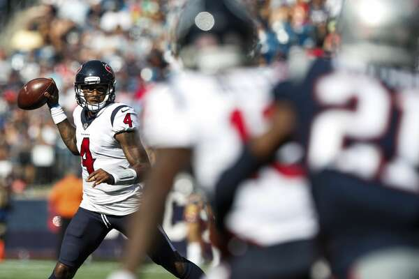 Houston Texans quarterback Deshaun Watson (4) rolls out to pass against the New England Patriots during the third quarter of an NFL football game at Gillette Stadium on Sunday, Sept. 24, 2017, in Foxbourough, Mass. ( Brett Coomer / Houston Chronicle )