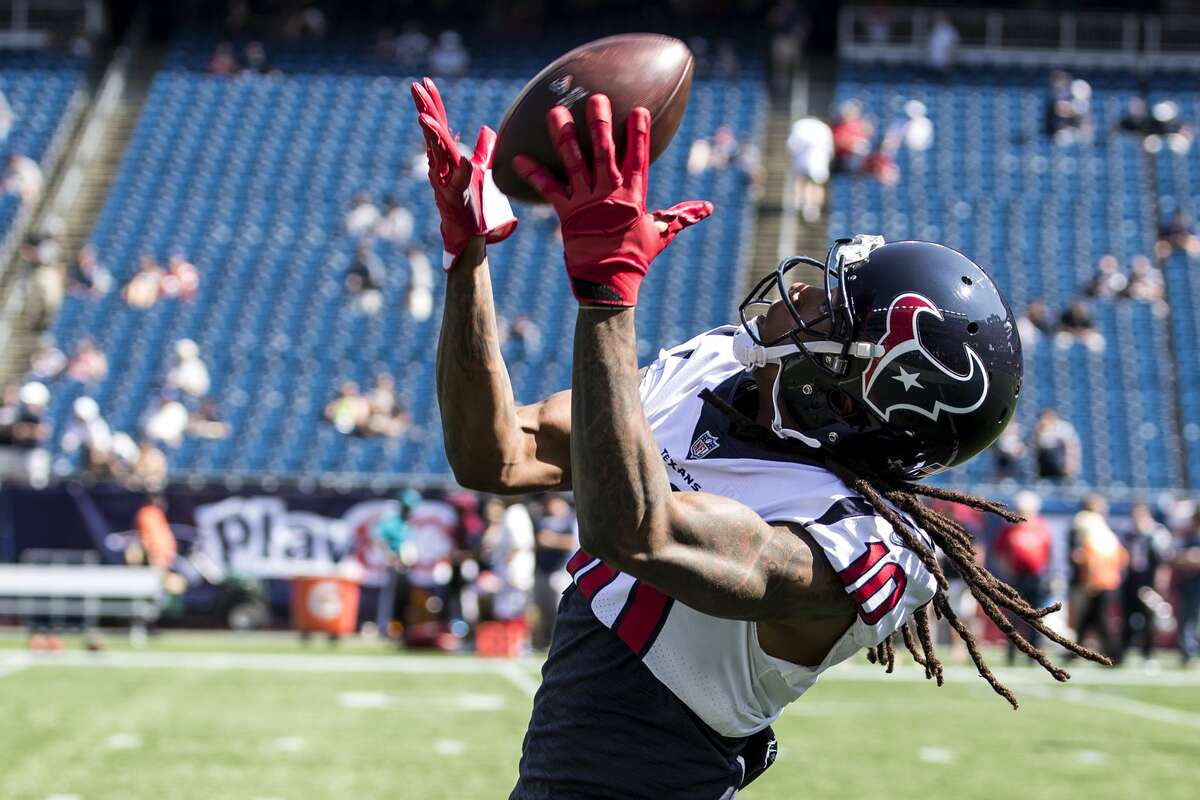 Houston Texans wide receiver DeAndre Hopkins (10) reaches out to make a catch before Texans NFL football game againt the New England Patriots at Gillette Stadium on Sunday, Sept. 24, 2017, in Foxbourough, Mass. ( Brett Coomer / Houston Chronicle )