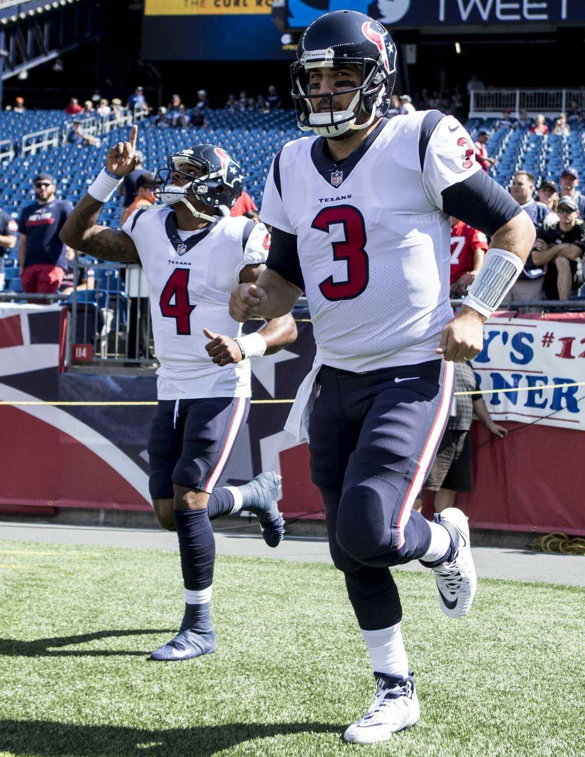 Houston Texans quarterbacks Deshaun Watson (4) and Tom Savage (3) run onto the field before Texans NFL football game againt the New England Patriots at Gillette Stadium on Sunday, Sept. 24, 2017, in Foxbourough, Mass. ( Brett Coomer / Houston Chronicle )