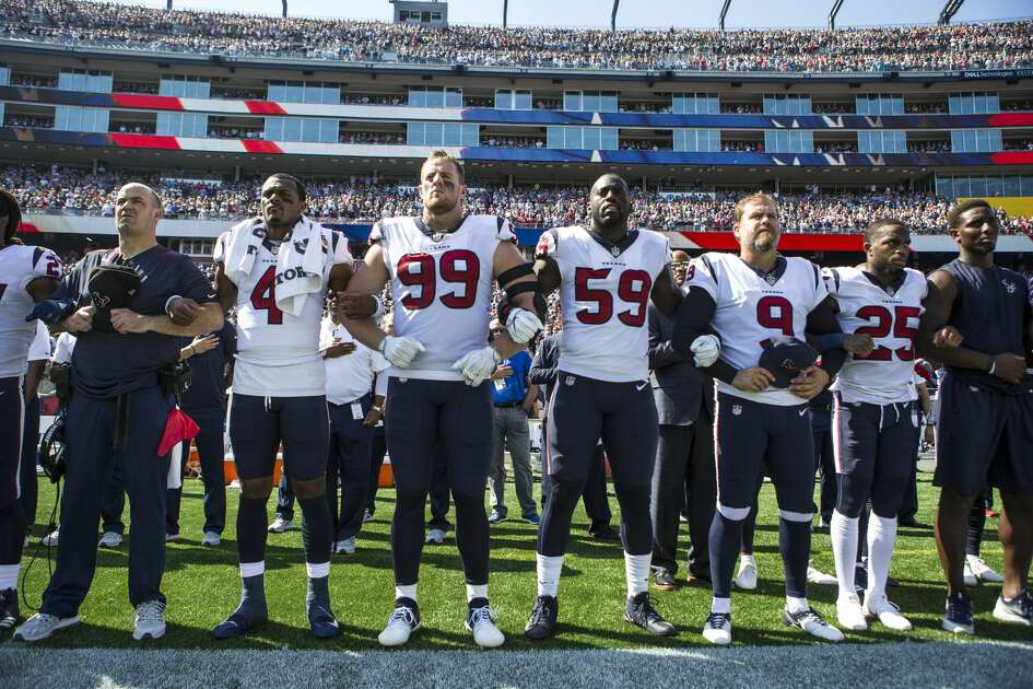 Houston Texans head coach Bill O'Brien lines up with his playes as they lock arm together dring the national anthem before an NFL football game against the New England Patriots at Gillette Stadium on Sunday, Sept. 24, 2017, in Foxbourough, Mass. ( Brett Coomer / Houston Chronicle )