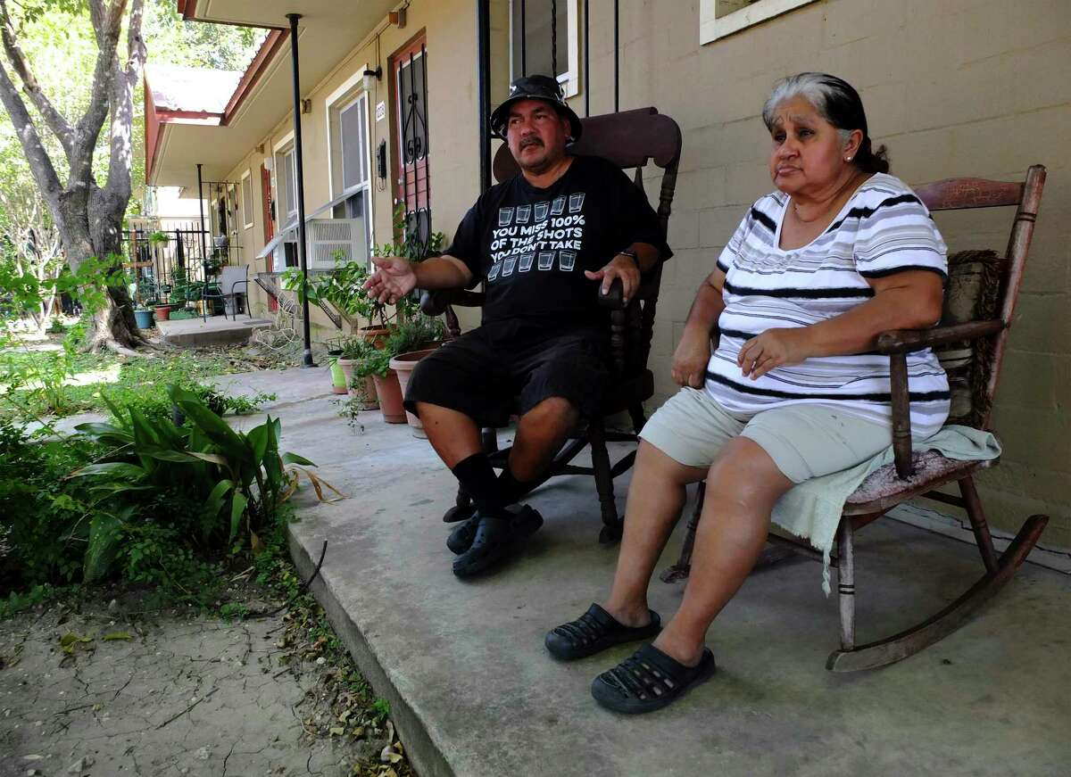 In 2017, Petra de la Rosa and her nephew, Roque Resendez, enjoy their porch at the Alazan Courts apartments complex. Plans to redevelop the complex have prompted concerns about gentrification and displacement.