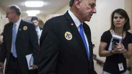 UNITED STATES - JUNE 21: Reps. Louie Gohmert, R-Texas, right, and Mike Conaway, R-Texas, leave a meeting of the House Republican Conference in the Capitol on June 21, 2017. Members wore fleur-de-lis stickers to honor House Majority Whip Steve Scalise, R-La., who was injured in last week's shooting at the Republican baseball practice. (Photo By Tom Williams/CQ Roll Call) (CQ Roll Call via AP Images)