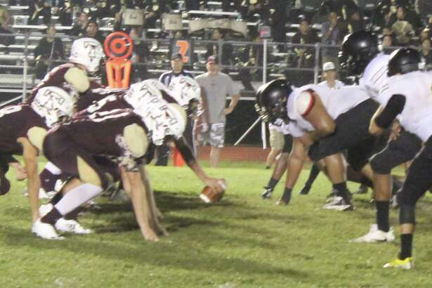 The Tarkington Longhorns (left) prepare to play offense against the Anahuac Panthers (right) during their Sept. 22 football game.