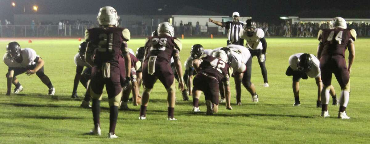The Tarkington Longhorns (front) defend against the Anahuac Panthers (back) at the end zone.