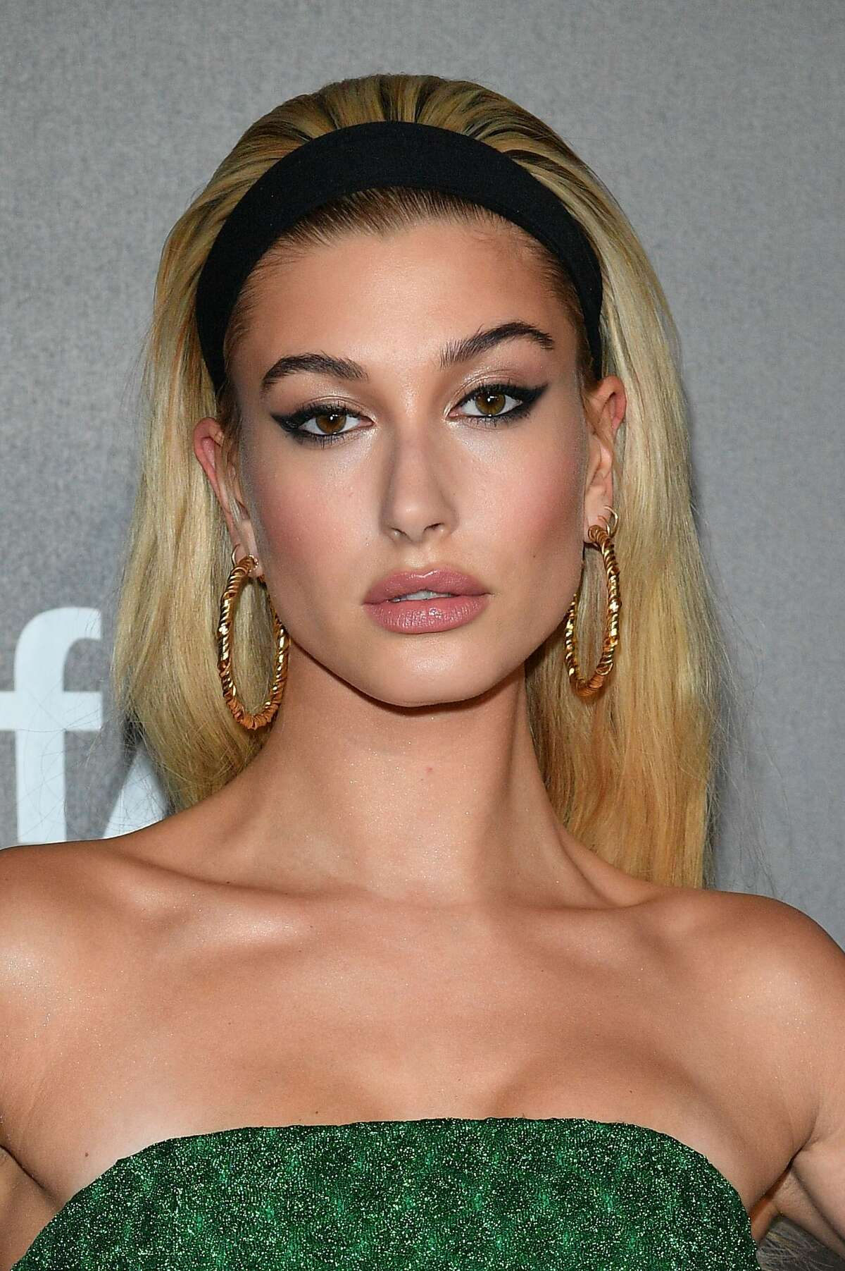 Hailey Baldwin walks the red carpet of amfAR Gala Milano on September 21, 2017. Check out Maxim's sexiest woman wearing a grandpa sweater...