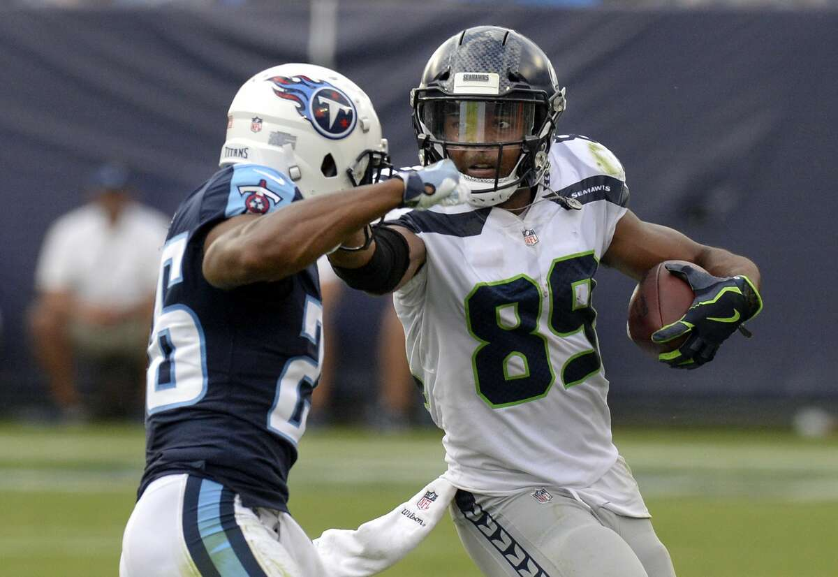 Seattle Seahawks wide receiver Doug Baldwin (89) tries to get past Tennessee Titans defensive back Logan Ryan (26) in the second half of an NFL football game Sunday, Sept. 24, 2017, in Nashville, Tenn. (AP Photo/Mark Zaleski)