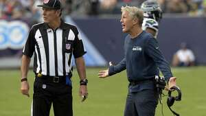 Seattle Seahawks head coach Pete Carroll argues a call in the first half of an NFL football game against the Tennessee Titans Sunday, Sept. 24, 2017, in Nashville, Tenn. (AP Photo/Mark Zaleski)