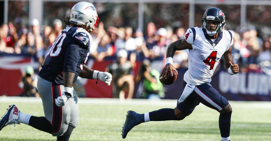PHOTOS: Patriots 36, Texans 33Houston Texans quarterback Deshaun Watson (4) runs out of the pocket with New England Patriots nose tackle Malcom Brown (90) chasing him down during the fourth quarter of an NFL football game at Gillette Stadium on Sunday, Sept. 24, 2017, in Foxbourough, Mass. ( Brett Coomer / Houston Chronicle )Browse through the photos to see action from the Texans' loss to the Patriots on Sunday. Photo: Brett Coomer/Houston Chronicle