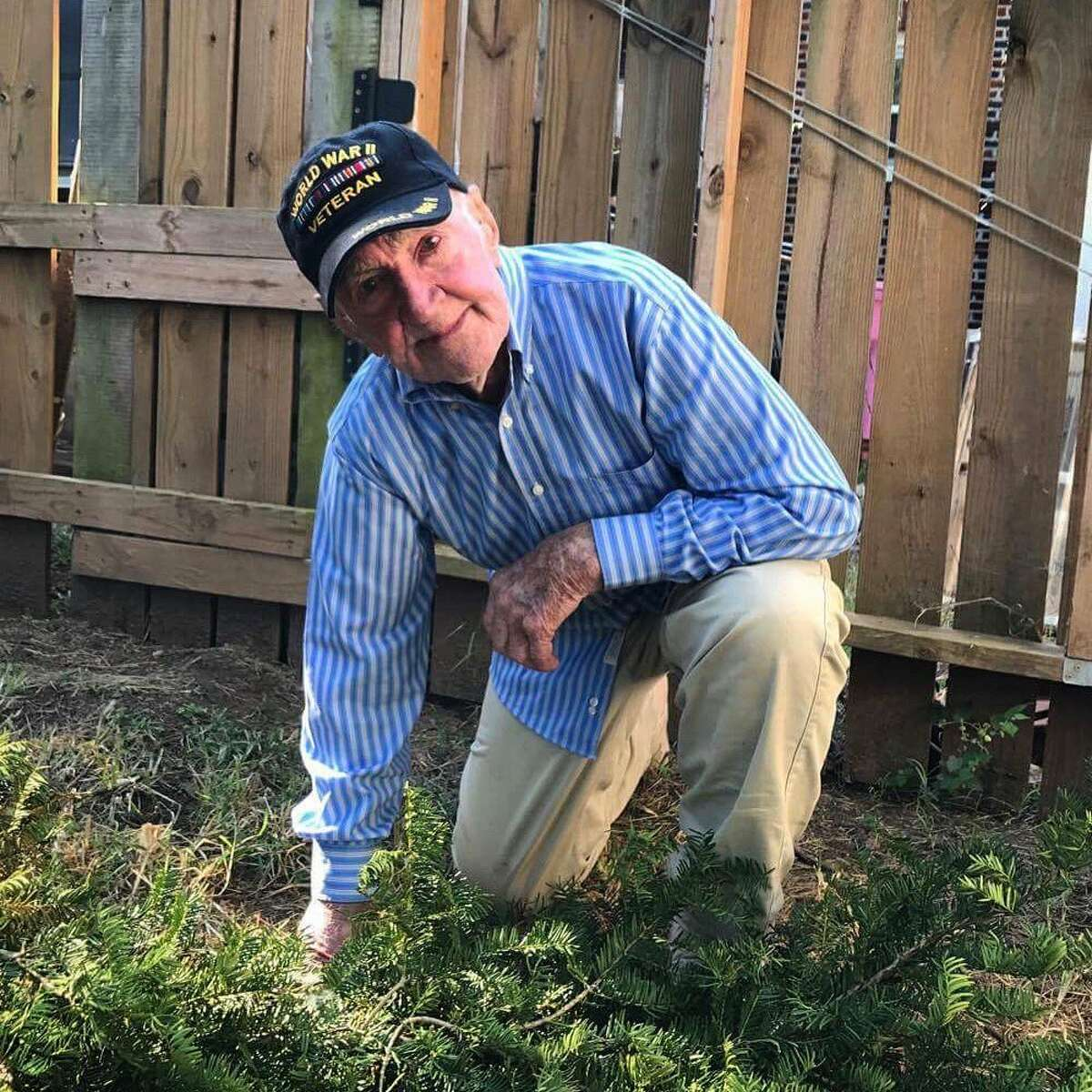 97-year-old John Middlemas kneels in a photo originally posted by his grandson Brennan Gilmore on Sunday, September 24, 2017.