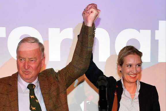 Alternative for Germany top candidates, Alexander Gauland, left, and Alice Weidel celebrate with their supporters during the election party after their group won Parliamentary seats.