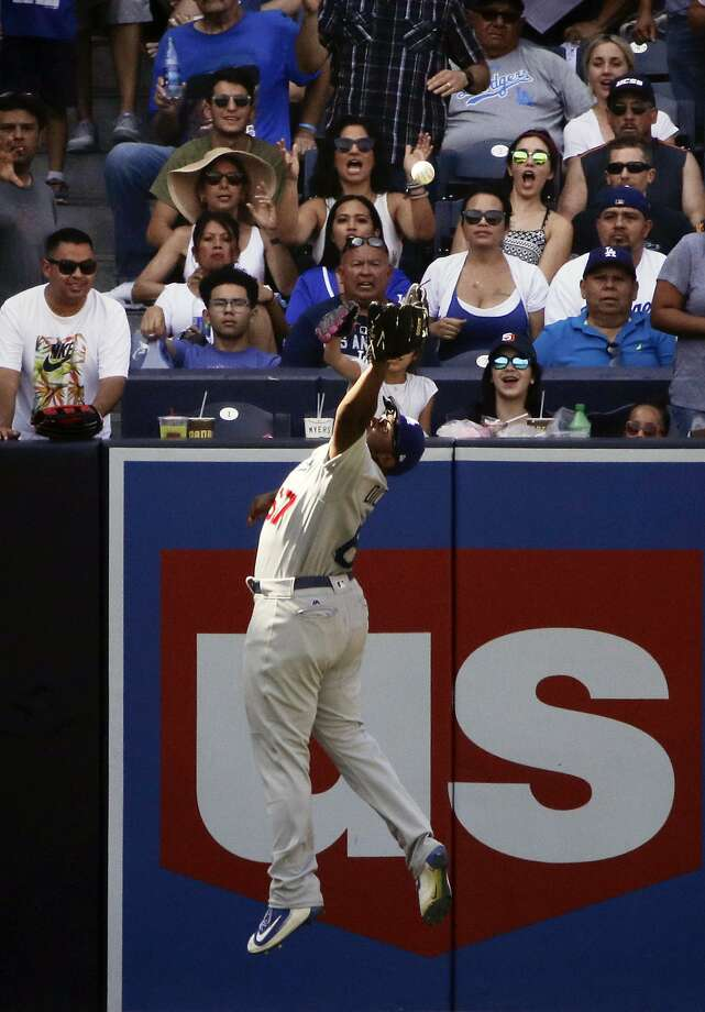 Los Angeles Dodgers' O'Koyea Dickson can't catch an RBI triple hit by San Diego Padres' Wil Myers during the seventh inning of a baseball game, Saturday, Sept. 2, 2017, in San Diego. (AP Photo/Jae C. Hong) Photo: Jae C. Hong, Associated Press