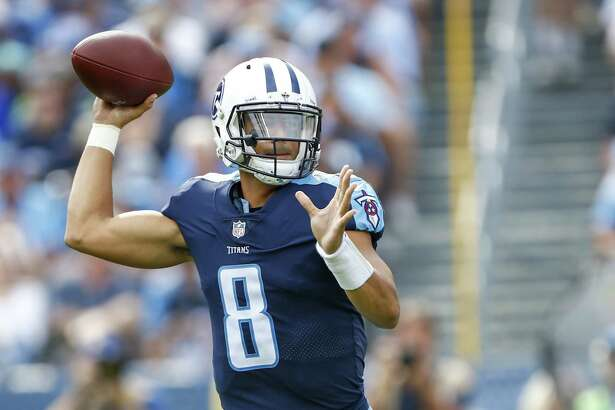 NASHVILLE, TN - SEPTEMBER 24: Quarterback Marcus Mariota  #8 of the Tennesee Titans makes a pass against Seattle Seahawks at Nissan Stadium on September 24, 2017 in Nashville, Tennessee. (Photo by Wesley Hitt/Getty Images)
