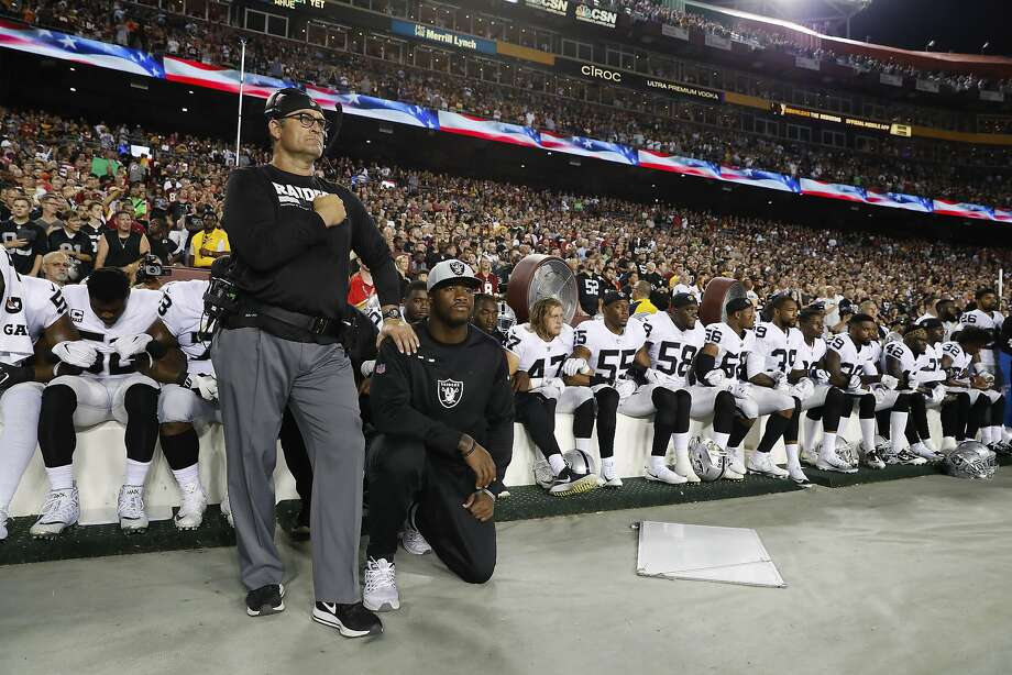 Some members of the Oakland Raiders kneel during the playing of the National Anthem before an NFL football game against the Washington Redskins in Landover, Md., Sunday, Sept. 24, 2017. (AP Photo/Alex Brandon) Photo: Alex Brandon, Associated Press
