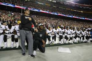 Some members of the Oakland Raiders kneel during the playing of the National Anthem before an NFL football game against the Washington Redskins in Landover, Md., Sunday, Sept. 24, 2017. (AP Photo/Alex Brandon)