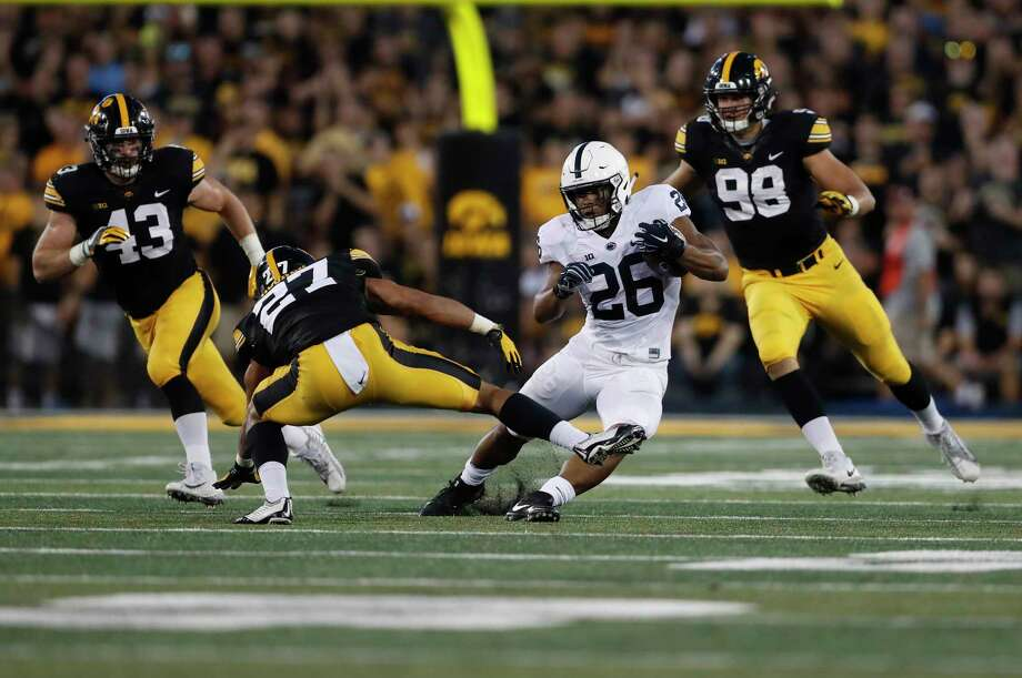 Penn State running back Saquon Barkley (26) turned the Iowa defense inside out Saturday, rushing for a career-high 211 yards on 28 carries and catching 12 passes for 94 yards in the Nittany Lions' 21-19 victory. Photo: Jeff Roberson, STF / Copyright 2017 The Associated Press. All rights reserved.
