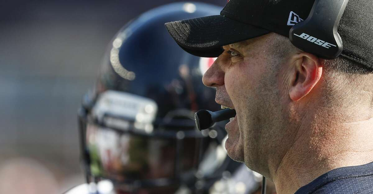 Houston Texans head coach Bill O'Brien makes a call on the sidelines during the third quarter of an NFL football game against the New England Patriots at Gillette Stadium on Sunday, Sept. 24, 2017, in Foxbourough, Mass. ( Brett Coomer / Houston Chronicle )