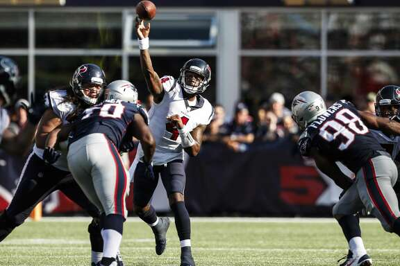 Houston Texans quarterback Deshaun Watson (4) throws a pass over the New England Patriots defensive tackle Adam Butler (70) during the fourth quarter of an NFL football game at Gillette Stadium on Sunday, Sept. 24, 2017, in Foxbourough, Mass. ( Brett Coomer / Houston Chronicle )