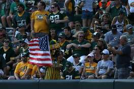 GREEN BAY, WI - SEPTEMBER 24:  A Green Bay Packers fan displays an American flag prior to the start of the game against the Cincinnati Bengals at Lambeau Field on September 24, 2017 in Green Bay, Wisconsin.  (Photo by Dylan Buell/Getty Images)