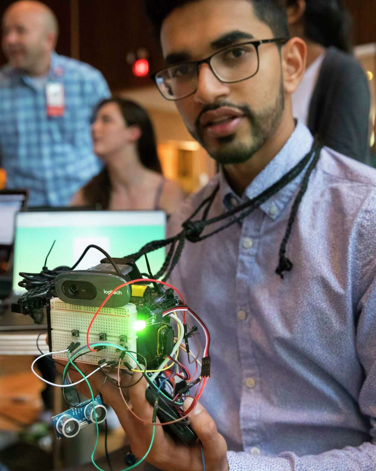 Harsh Patel holds the Memoreyes facial recognition device during HackRice, Rice University's annual hackathron event sponsored by the university's Computer Science Club.