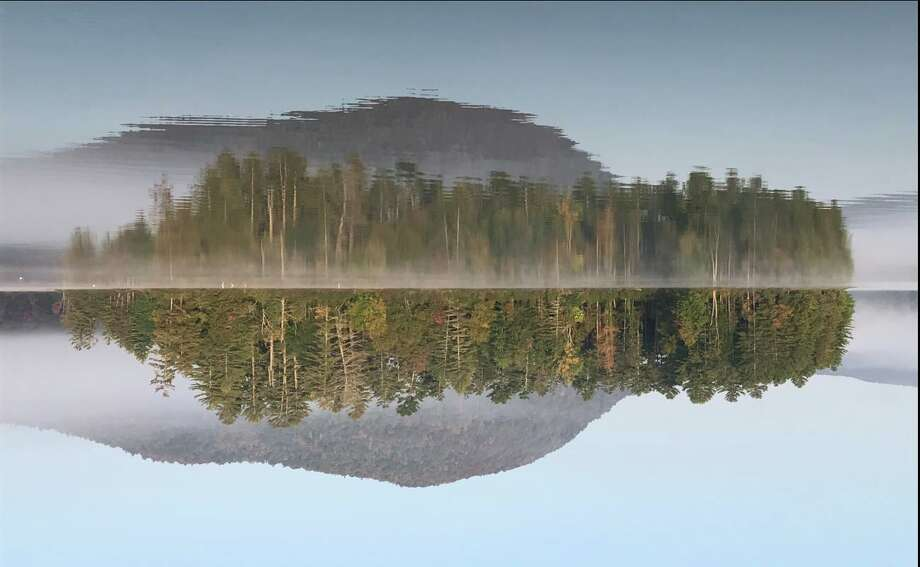 Gerry Morris of Schenectady shares a reflection of Piseco Lake?s Pine Island this season from a different point of view.