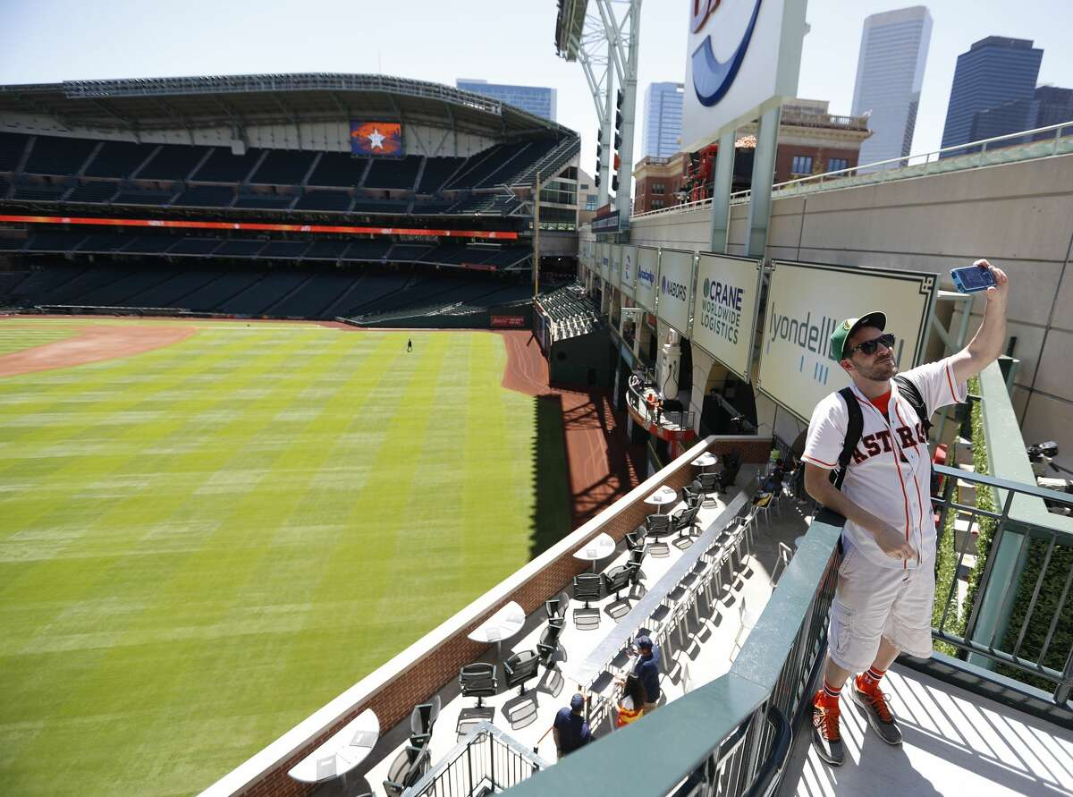 Chris Glaser takes a selfie from the new center field patio before the start of the Houston Astros at Minute Maid Park, Friday, March 31, 2017, in Houston. ( Karen Warren / Houston Chronicle )
