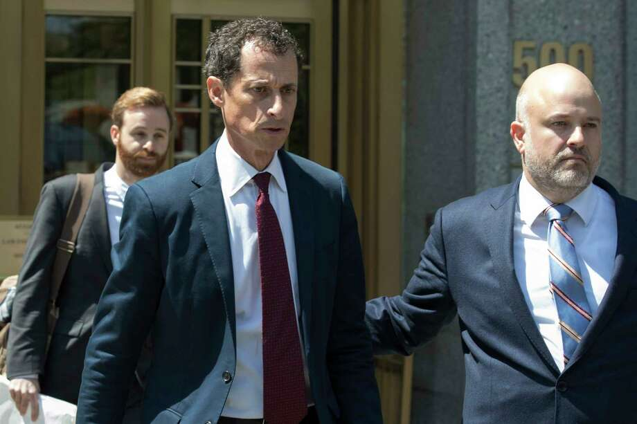 FILE - In this May 19, 2017, file photo, former U.S. Rep. Anthony Weiner, left, leaves Federal court in New York after pleading guilty to a charge of transmitting sexual material to a minor. Weiner is to be sentenced Monday, Sept. 25, 2017, for sending obscene material to a 15-year-old girl in 2016. (AP Photo/Mary Altaffer, File) ORG XMIT: NYR402 Photo: Mary Altaffer / Copyright 2017 The Associated Press. All rights reserved.