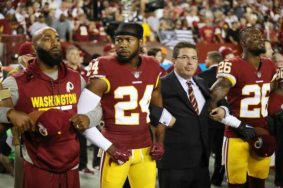 LANDOVER, MD - SEPTEMBER 24: Washington Redskins Owner Daniel Synder stands with cornerback Josh Norman #24 of the Washington Redskins and cornerback Bashaud Breeland #26 of the Washington Redskins during the the national anthem before the game against the Oakland Raiders at FedExField on September 24, 2017 in Landover, Maryland. (Photo by Patrick Smith/Getty Images)