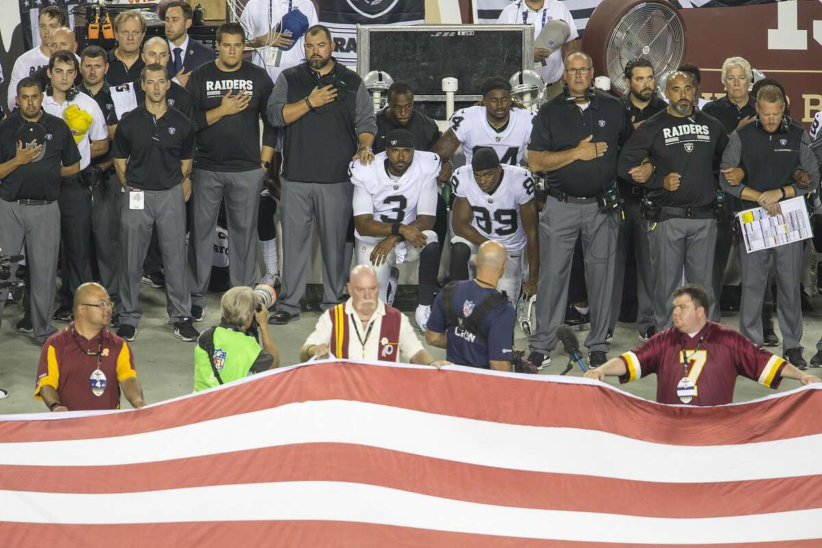 LANDOVER, MD - SEPTEMBER 24: Oakland Raiders players sit during the national anthem before they take on the Washington Redskins at FedExField on September 24, 2017 in Landover, Maryland. (Photo by Tasos Katopodis/Getty Images)
