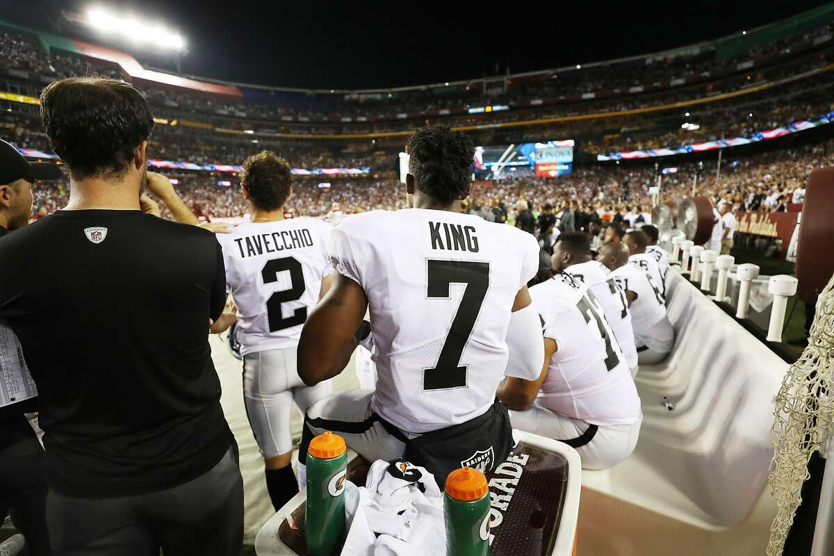 LANDOVER, MD - SEPTEMBER 24: Punter Marquette King #7 of the Oakland Raiders sits during the national anthem before they take on the Washington Redskins at FedExField on September 24, 2017 in Landover, Maryland. (Photo by Rob Carr/Getty Images)