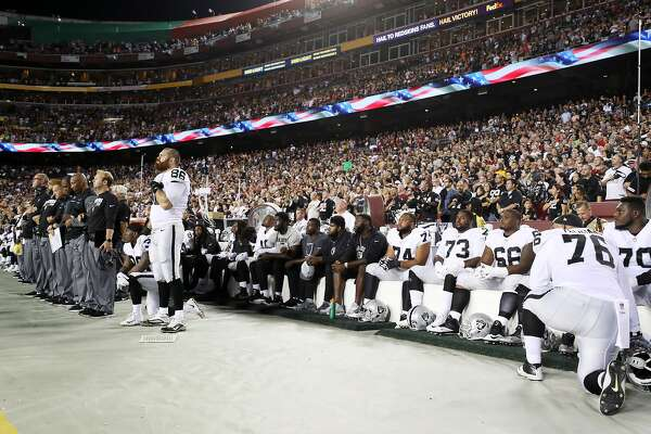 LANDOVER, MD - SEPTEMBER 24: Oakland Raiders players sit during the national anthem before they take on the Washington Redskins at FedExField on September 24, 2017 in Landover, Maryland.  (Photo by Rob Carr/Getty Images)