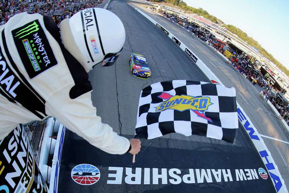 Kyle Busch takes the checkered flag to win the Monster Energy Cup race at New Hampshire Motor Speedway and advance to the next round of the playoffs. Photo: Jonathan Ferrey, Stringer / 2017 Getty Images