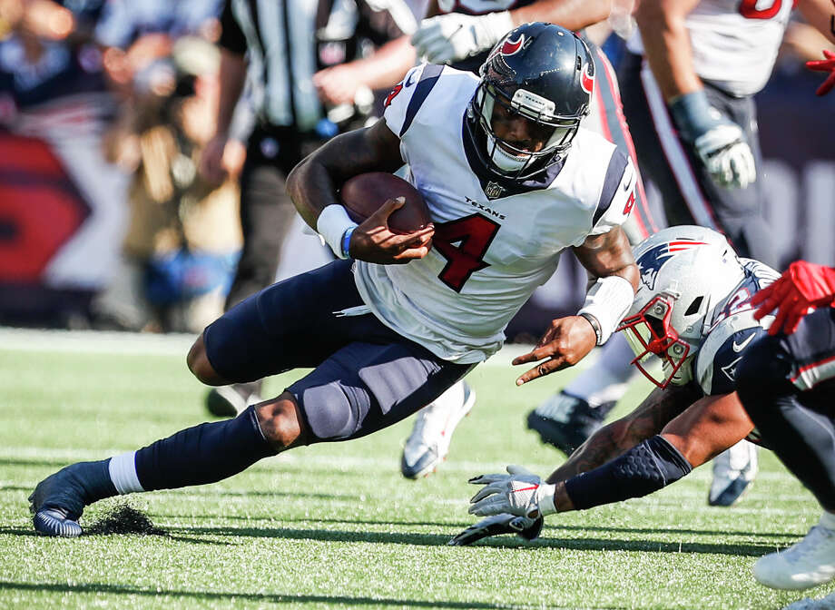 "Described as ""slippery"" by one Patriots defender, Texans quarterback Deshaun Watson (4) was just that Sunday, especially on this run for a first down in the fourth quarter. Photo: Brett Coomer, Staff / © 2017 Houston Chronicle"