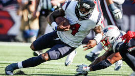 """Described as """"slippery"""" by one Patriots defender, Texans quarterback Deshaun Watson (4) was just that Sunday, especially on this run for a first down in the fourth quarter."""