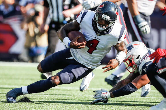 "Described as ""slippery"" by one Patriots defender, Texans quarterback Deshaun Watson (4) was just that Sunday, especially on this run for a first down in the fourth quarter."
