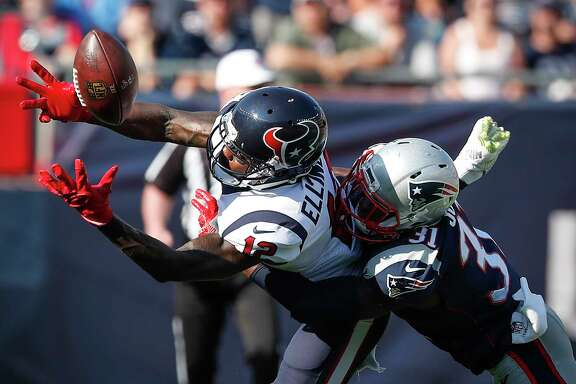 Texans wide receiver Bruce Ellington (12) makes a catch against Patriots cornerback Jonathan Jones (31) during the third quarter Sunday. Ellington made four catches for 59 yards and a touchdown against the Patriots.