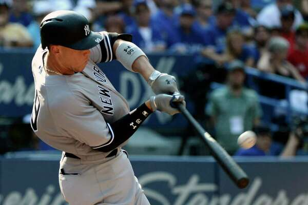 New York Yankees' Aaron Judge hits a two-run home run during the seventh inning of a baseball game against the Toronto Blue Jays, Sunday, Sept. 24, 2017, in Toronto. (Jon Blacker/The Canadian Press via AP) ORG XMIT: JCB111