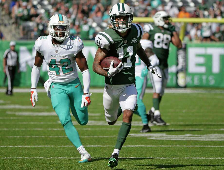 Miami Dolphins' Alterraun Verner (42) chases New York Jets' Robby Anderson (11) as Anderson runs for a touchdown during the first half of an NFL football game Sunday, Sept. 24, 2017, in East Rutherford, N.J. (AP Photo/Seth Wenig) ORG XMIT: ERU112 Photo: Seth Wenig / Copyright 2017 The Associated Press. All rights reserved.