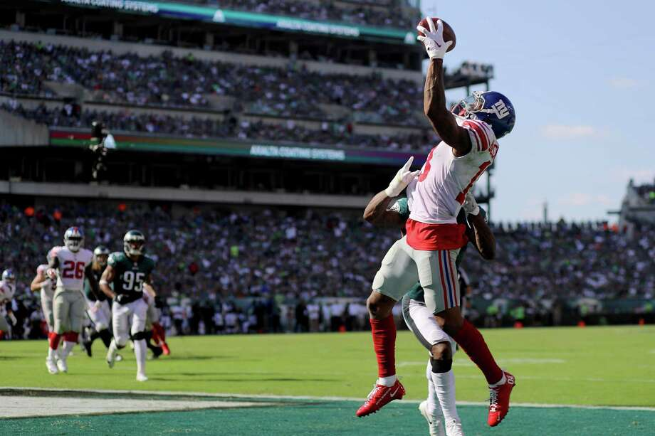 PHILADELPHIA, PA - SEPTEMBER 24: Odell Beckham #13 of the New York Giants completes a four yard touchdown catch against Jalen Mills #31 of the Philadelphia Eagles in the third quarter on September 24, 2017  at Lincoln Financial Field in Philadelphia, Pennsylvania.  (Photo by Abbie Parr/Getty Images) ORG XMIT: 700070636 Photo: Abbie Parr / 2017 Getty Images