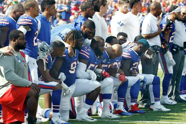 Buffalo Bills players take a knee during the playing of the national anthem prior to an NFL football game against the Denver Broncos, Sunday, Sept. 24, 2017, in Orchard Park, N.Y. (AP Photo/Jeffrey T. Barnes) ORG XMIT: NYJC105