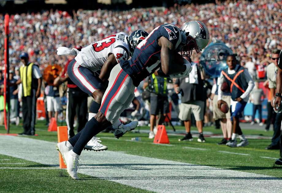 New England Patriots wide receiver Brandin Cooks, right, drags his toes as he makes the game-winning catch in the end zone for a touchdown in front of Houston Texans safety Corey Moore, left, during the second half of an NFL football game, Sunday, Sept. 24, 2017, in Foxborough, Mass. The Patriots won 36-33. (AP Photo/Michael Dwyer) ORG XMIT: FBO134 Photo: Michael Dwyer / Copyright 2017 The Associated Press. All rights reserved.