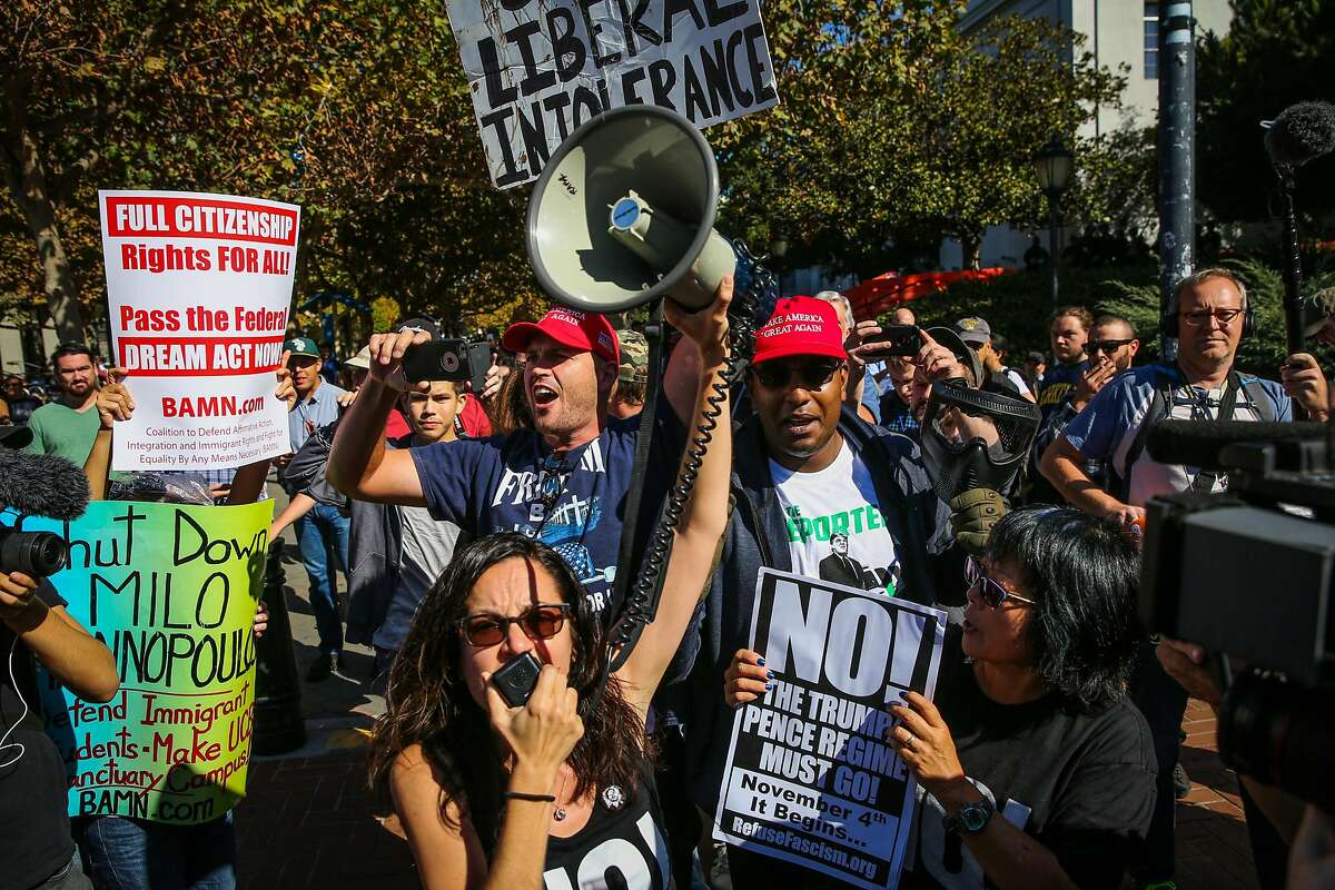 Trump supporters Ben Bergquam (back, left) and Roger Walus (back right) yell out as anti-Trump supporters Sunsara Taylor (center,bottom) and others demonstrate outside UC Berkelely in Berkeley, Calif., on Sunday, Sept. 24, 2017.