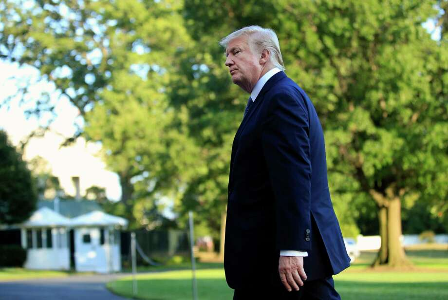 President Donald Trump walks towards the White House in Washington, Sunday, Sept. 24, 2017, after speaking to reporters upon his return. Citizens of eight countries will face new restrictions on entry to the U.S. under a proclamation signed by Trump on Sunday. (AP Photo/Manuel Balce Ceneta) ORG XMIT: WHMC105 Photo: Manuel Balce Ceneta / Copyright 2017 The Associated Press. All rights reserved.